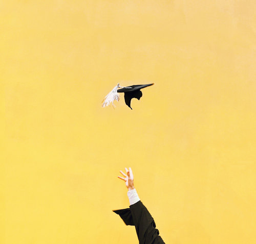Photo of a college graduation cap being thrown into the air