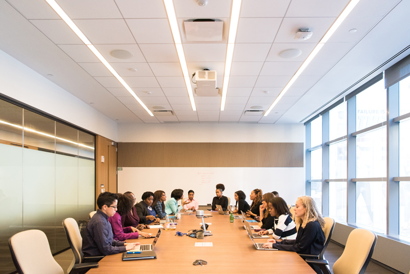 Photo of a group of people in a conference room