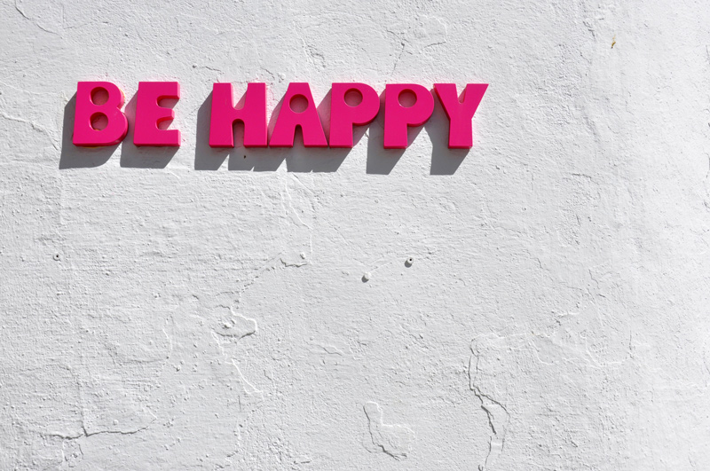 Photo of block lettering of the words 'Be Happy'