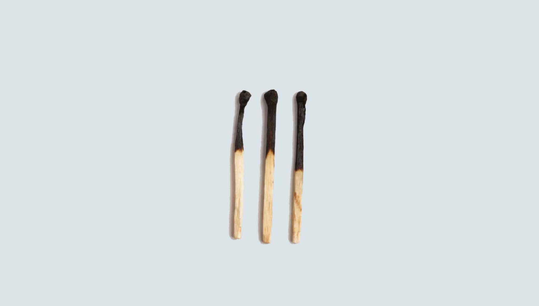Photo of three matchsticks next to each other