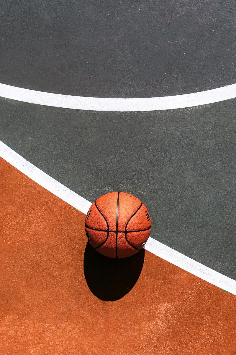 Photo of a basketball on a court outside